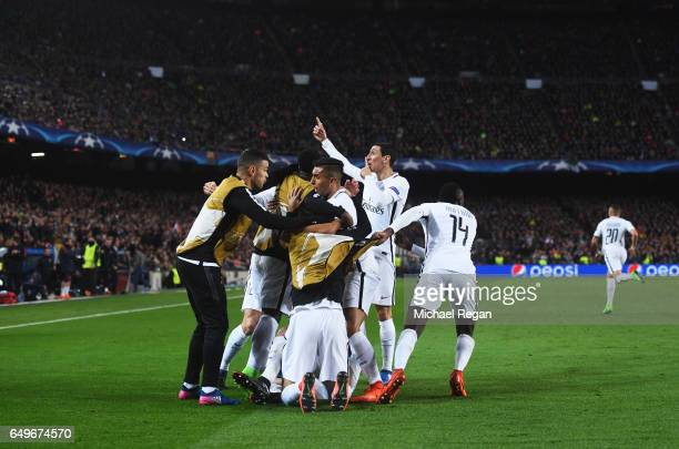 Edinson Cavani of Edinson Cavani of PSG celebrates with team mates as he scores their first goal during the UEFA Champions League Round of 16 second...