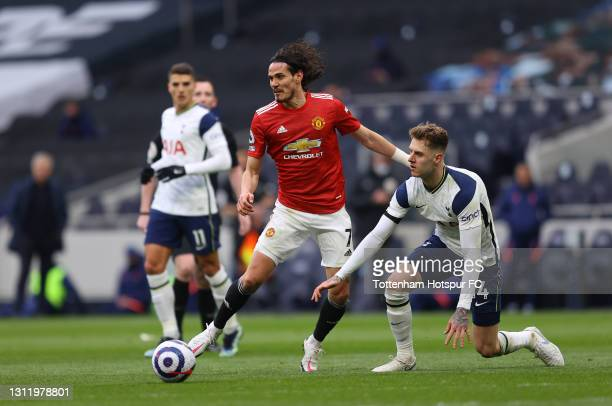 Edinson Cavani of Manchester United battles for possession with Joe Rodon of Tottenham Hotspur during the Premier League match between Tottenham...