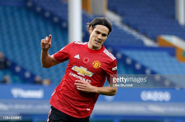 Edinson Cavani of Manchester United celebrates after scoring his team's third goal during the Premier League match between Everton and Manchester...