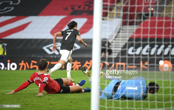 Edinson Cavani of Manchester United celebrates after scoring their sides third goal as Alex McCarthy and Jannick Vestergaard of Southampton look...