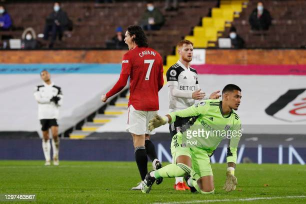 Edinson Cavani of Manchester United celebrates after scoring their team's first goal as Alphonse Areola of Fulham reacts during the Premier League...