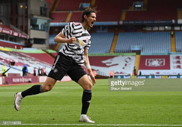 Edinson Cavani of Manchester United celebrates after scoring their team's third goal during the Premier League match between Aston Villa and...