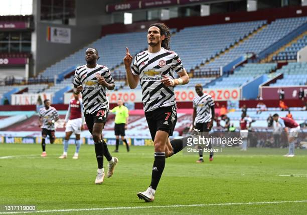 Edinson Cavani of Manchester United celebrates after scoring their side's third goal during the Premier League match between Aston Villa and...