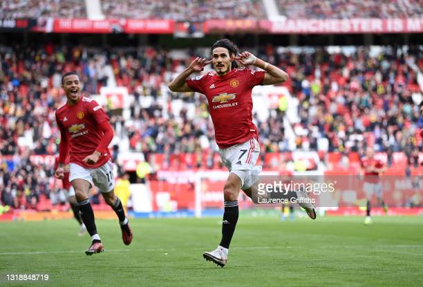 Edinson Cavani of Manchester United celebrates after scoring their side's first goal as Mason Greenwood looks on during the Premier League match...