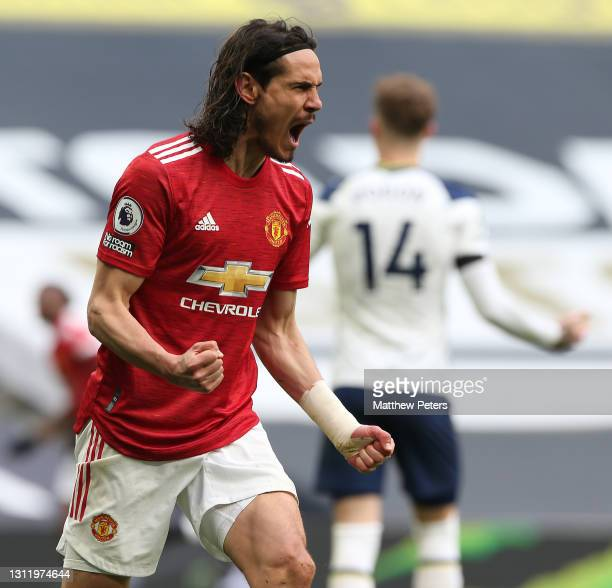 Edinson Cavani of Manchester United celebrates Fred scoring their first goal during the Premier League match between Tottenham Hotspur and Manchester...