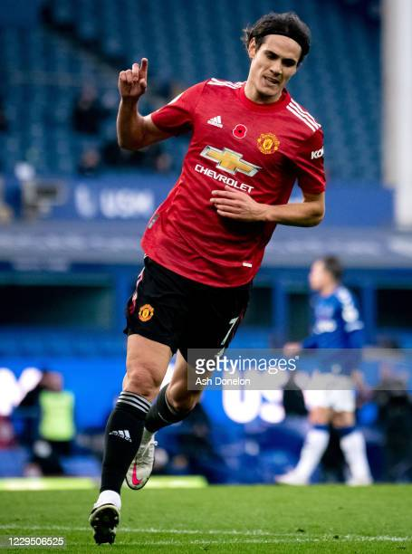 Edinson Cavani of Manchester United celebrates scoring a goal to make the score 1-3 during the Premier League match between Everton and Manchester...