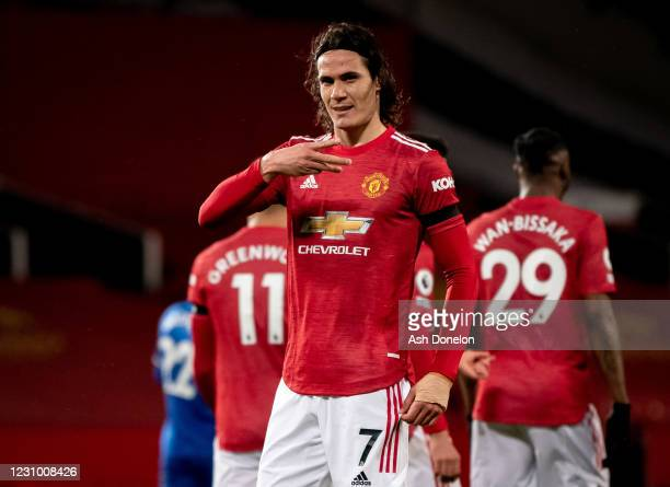 Edinson Cavani of Manchester United celebrates scoring a goal to make the score 1-0 during the Premier League match between Manchester United and...