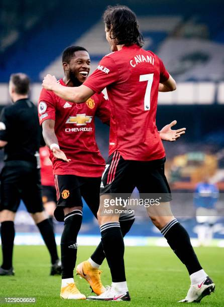 Edinson Cavani of Manchester United celebrates scoring a goal with Fred to make the score 1-3 during the Premier League match between Everton and...