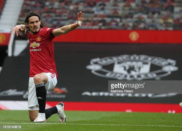 Edinson Cavani of Manchester United celebrates scoring their third goal during the Premier League match between Manchester United and Burnley at Old...