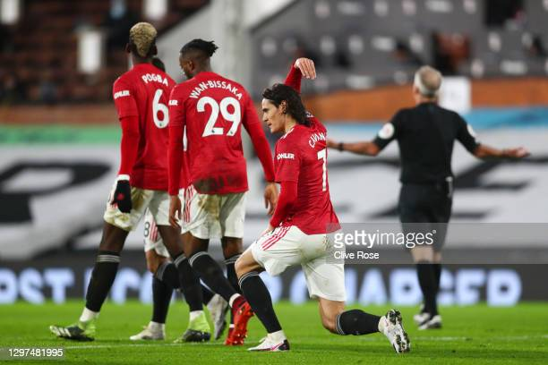 Edinson Cavani of Manchester United celebrates with Aaron Wan-Bissaka and Paul Pogba after scoring their teams first goal during the Premier League...