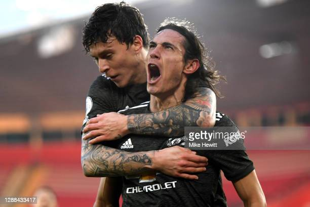 Edinson Cavani of Manchester United celebrates with team mate Victor Lindelof after scoring their sides second goal during the Premier League match...