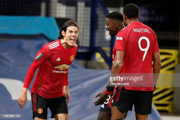 Edinson Cavani of Manchester United celebrates with team mates Axel Tuanzebe and Anthony Martial after scoring their sides first goal during the...