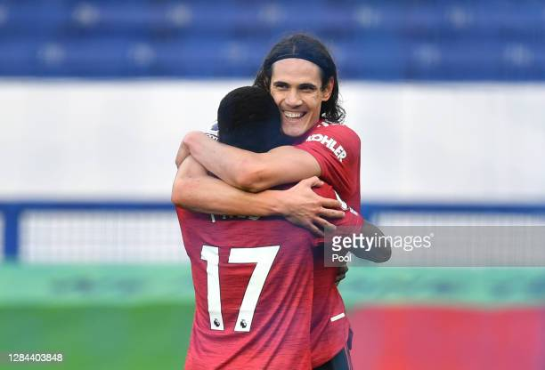 Edinson Cavani of Manchester United celebrates with teammate Fred after scoring his team's third goal during the Premier League match between Everton...