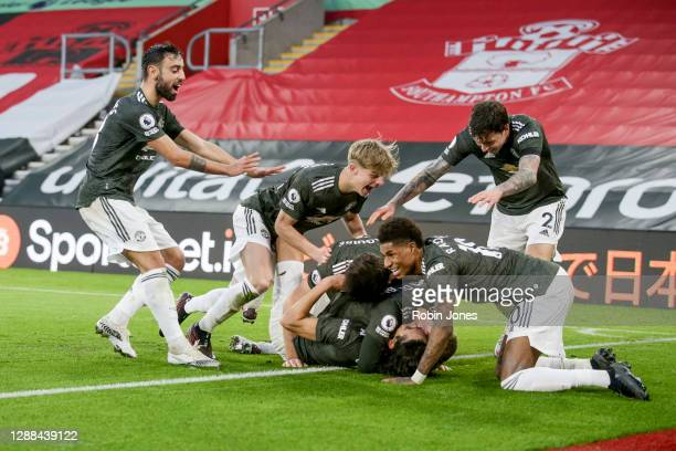 Edinson Cavani of Manchester United celebrates with teammates Bruno Fernandes Brandon Williams Harry Maguire Donny van de Beek Marcus Rashford and...