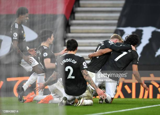 Edinson Cavani of Manchester United celebrates with teammates Donny van de Beek Victor Lindelof Harry Maguire and Marcus Rashford of Manchester...