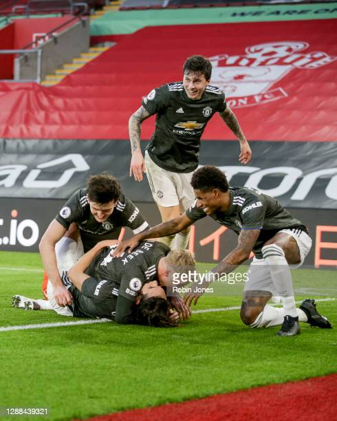 Edinson Cavani of Manchester United celebrates with teammates Harry Maguire Donny van de Beek Marcus Rashford and Victor Lindelof after he heads in...