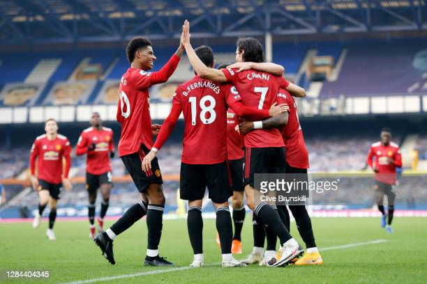 Edinson Cavani of Manchester United celebrates with teammates Marcus Rashford and Bruno Fernandes after scoring his team's third goal during the...