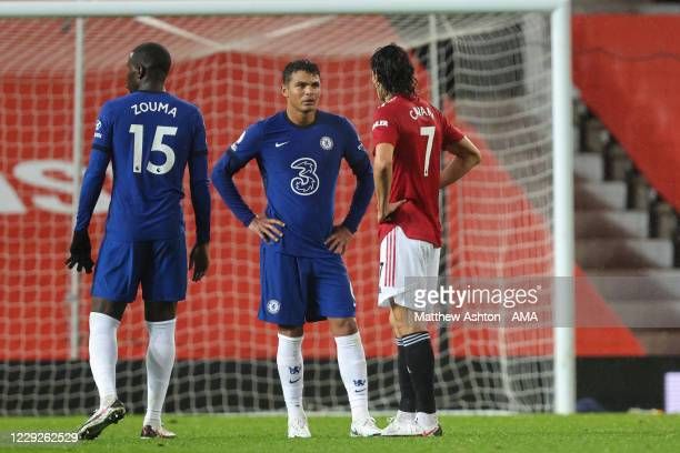 Edinson Cavani of Manchester United chats to old Paris SaintGermain team mate Thiago Silva of Chelsea during the Premier League match between...