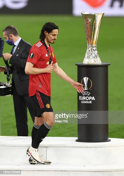 Edinson Cavani of Manchester United cuts a dejected figure as they make their way past the UEFA Europa League Trophy following the UEFA Europa League...