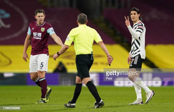 Edinson Cavani of Manchester United gestures towards referee Kevin Friend as James Tarkowski of Burnley reacts during the Premier League match...