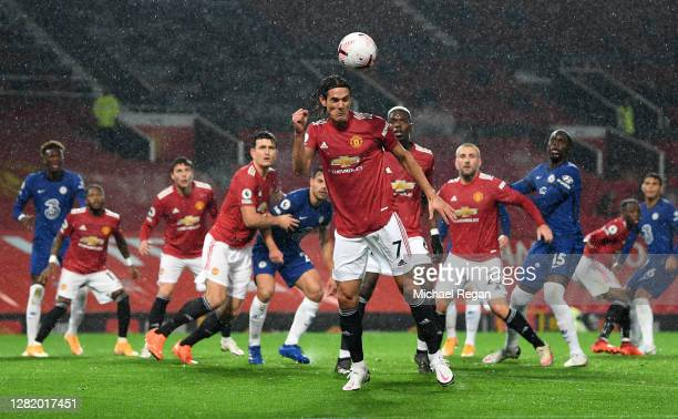 Edinson Cavani of Manchester United heads to clear the ball during the Premier League match between Manchester United and Chelsea at Old Trafford on...