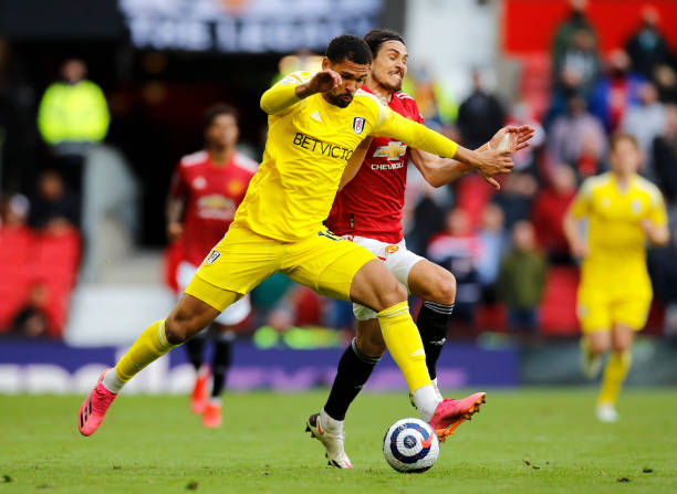 Edinson Cavani of Manchester United is challenged by Ruben Loftus-Cheek of Fulham during the Premier League match between Manchester United and...