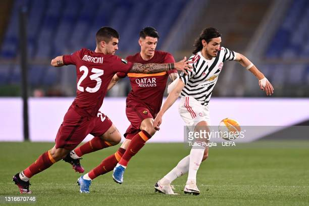 Edinson Cavani of Manchester United is closed down by Gianluca Mancini and Roger Ibanez of A.S Roma during the UEFA Europa League Semi-final Second...