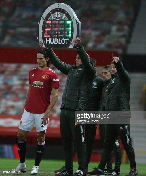 Edinson Cavani of Manchester United prepares to come on as a substitute during the Premier League match between Manchester United and Chelsea at Old...