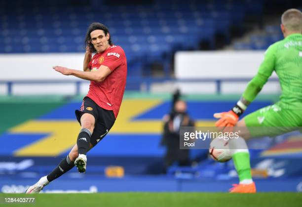 Edinson Cavani of Manchester United scores his team's third goal during the Premier League match between Everton and Manchester United at Goodison...
