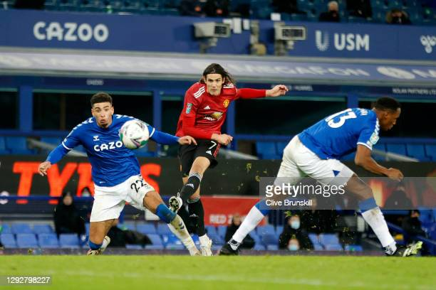 Edinson Cavani of Manchester United scores their sides first goal whilst under pressure from Ben Godfrey of Everton during the Carabao Cup Quarter...