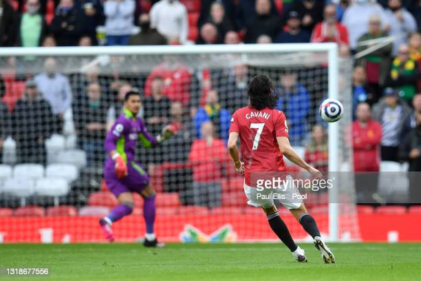 Edinson Cavani of Manchester United scores their side's first goal past Alphonse Areola of Fulham during the Premier League match between Manchester...