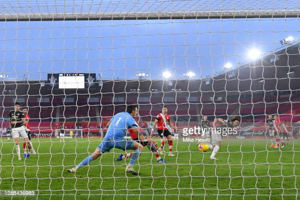 Edinson Cavani of Manchester United scores their sides third goal past Alex McCarthy of Southampton during the Premier League match between...