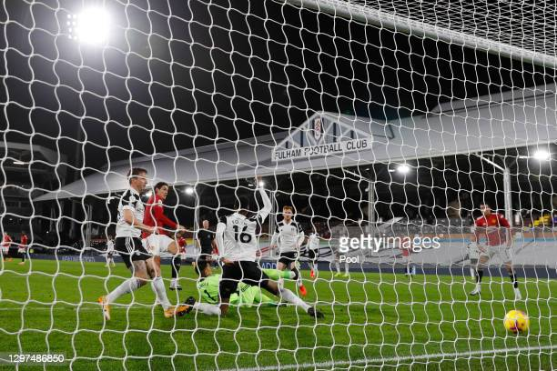 Edinson Cavani of Manchester United scores their team's first goal during the Premier League match between Fulham and Manchester United at Craven...