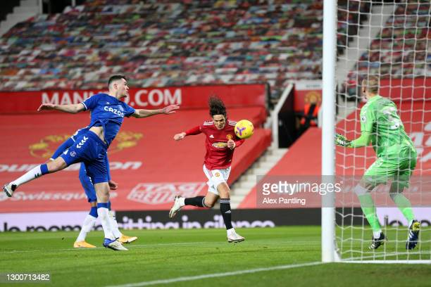 Edinson Cavani of Manchester United scores their team's first goal past Robin Olsen of Everton during the Premier League match between Manchester...