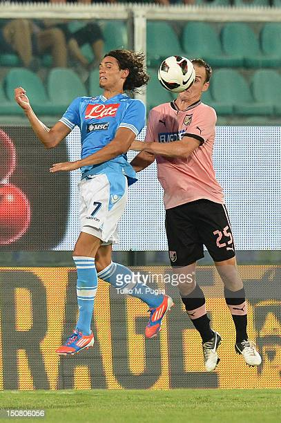 Edinson Cavani of Napoli and Steve Von Bergenof Palermo jump for the ball during the Serie A match between US Citta di Palermo and SSC Napoli at...