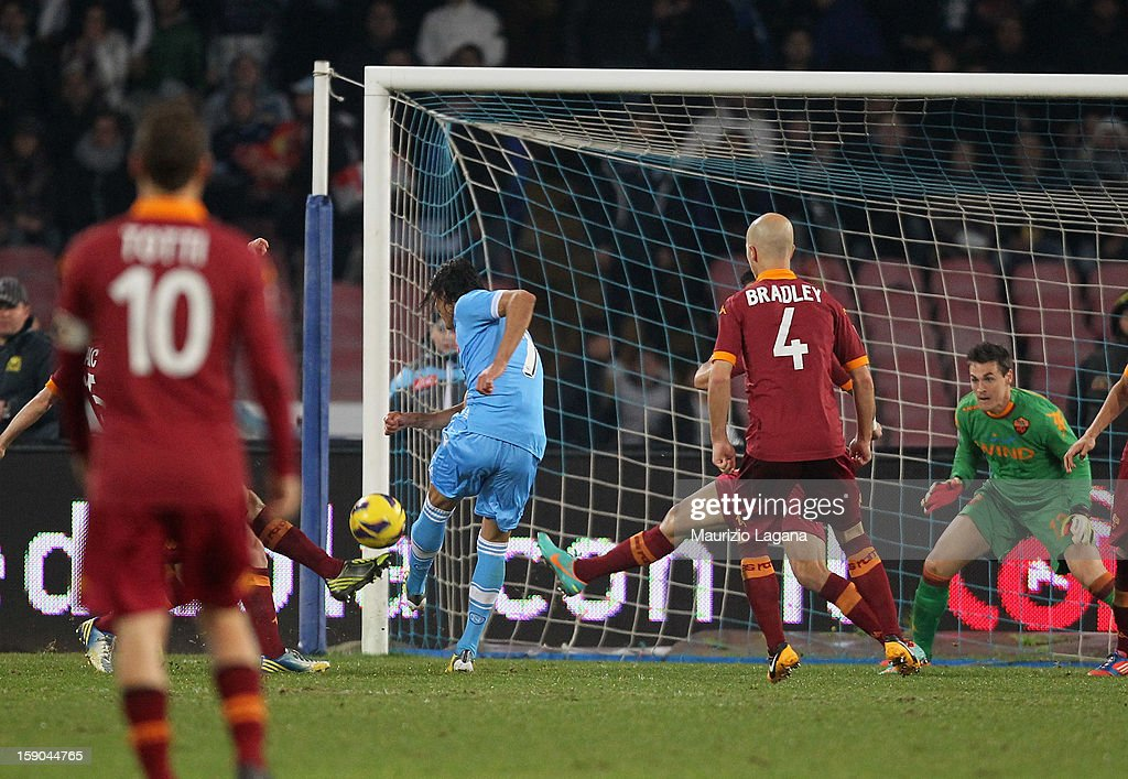 Edinson Cavani of Napoli scores his second goal during the Serie A match between SSC Napoli and AS Roma at Stadio San Paolo on January 6, 2013 in Naples, Italy.
