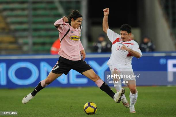 Edinson Cavani of Palermo and Riccardo Allegretti of Bari compete for the ball during the Serie A match between Bari and Palermo at Stadio San Nicola...