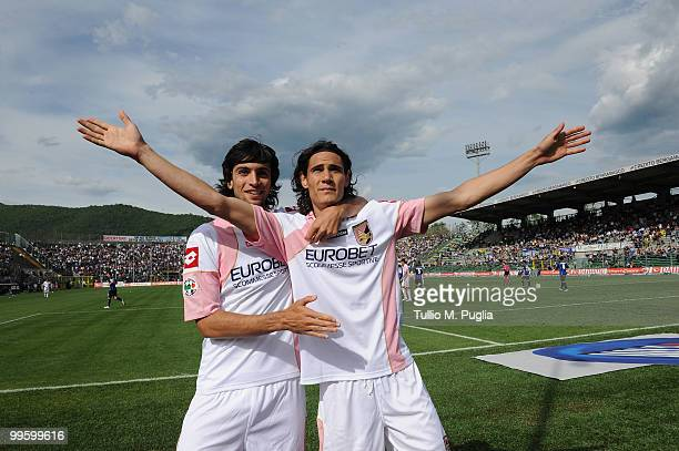 Edinson Cavani of Palermo celebrates with his team mate Javier Pastore after scoring a penalty during the Serie A match between Atalanta BC and US...