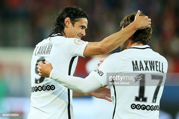 Edinson Cavani of Paris Saint Germain celebrates with Scherrer Maxwell after scoring a goal during the Ligue 1 match between SM Caen and Paris Saint...
