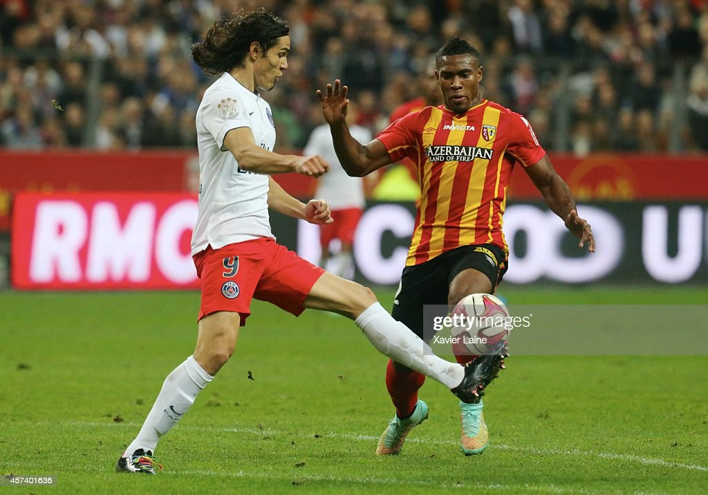 Edinson Cavani of Paris Saint-Germain and Loick Landre of RC Lens FC in action during the French Ligue 1 between RC Lens and Paris Saint-Germain FC at Stade de France on October 17, 2014 in Paris, France.