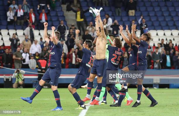 Edinson Cavani of Paris SaintGermain and teammattes celebrate the victory with fan after the French Ligue 1 match between Paris Saint Germain and AS...