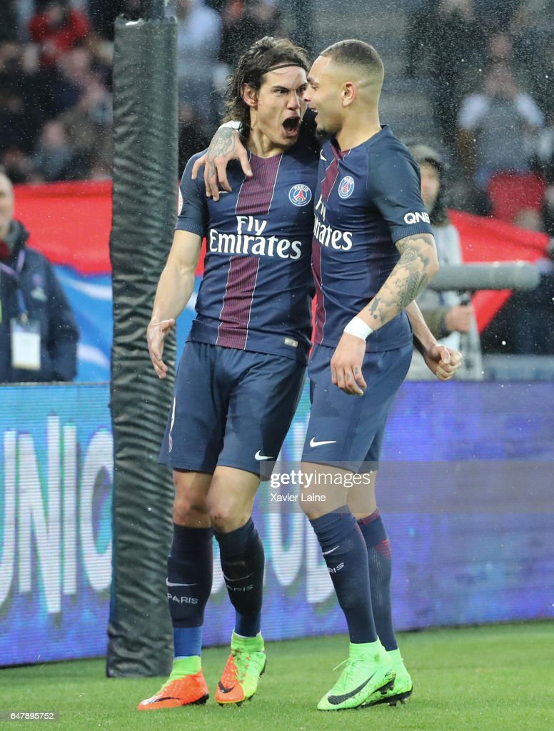 Edinson Cavani of Paris Saint-Germain celebrate his goal during with Layvin Kurzawa the French Ligue 1 match between Paris Saint-Germain and AS Nancy-Lorraine at Parc des Princes on March 4, 2017 in Paris, France.