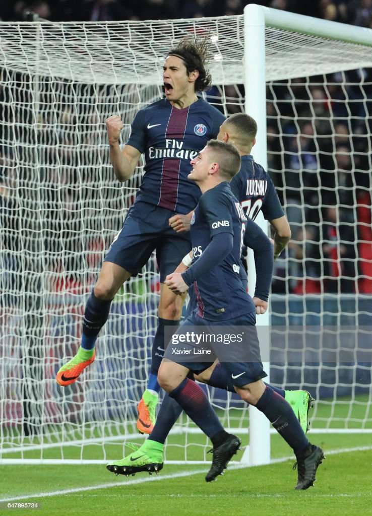 Edinson Cavani of Paris Saint-Germain celebrate his goal with Marco Verratti an Layvin Kurzawa during the French Ligue 1 match between Paris Saint-Germain and AS Nancy-Lorraine at Parc des Princes on March 4, 2017 in Paris, France.