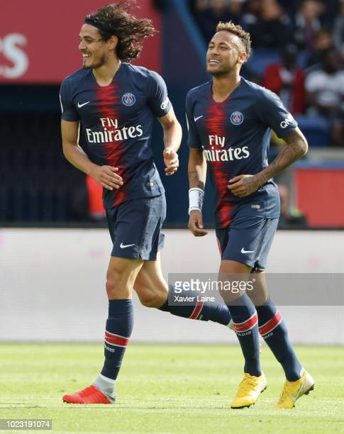 Edinson Cavani of Paris SaintGermain celebrate his goal with Neymar Jr during the Ligue 1 match between Paris SaintGermain and SCO Angers at Parc des...