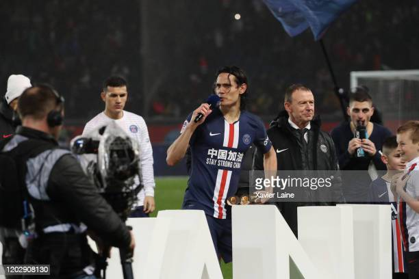 Edinson Cavani of Paris SaintGermain celebrate his trophy for the 200 goals scored for the club with teammattes after the Ligue 1 match between Paris...