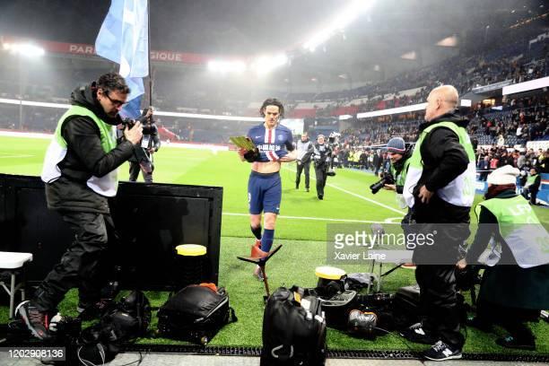 Edinson Cavani of Paris SaintGermain celebrate his trophy for the 200 goals scored for the club during the Ligue 1 match between Paris SaintGermain...