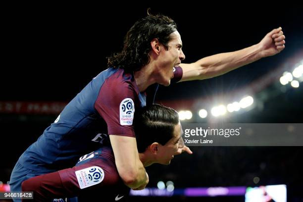 Edinson Cavani of Paris SaintGermain celebrate the goal of Angel Di Maria during the Ligue 1 match between Paris Saint Germain and AS Monaco at Parc...