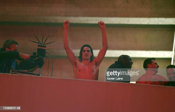 Edinson Cavani of Paris SaintGermain celebrate the victory with fans outside the stadium after UEFA Champions League round of 16 second leg match...