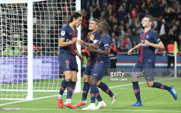 Edinson Cavani of Paris SaintGermain celebrates his goal with Moussa Diaby Marco Verratti and Julian Draxler during the French Ligue 1 match between...