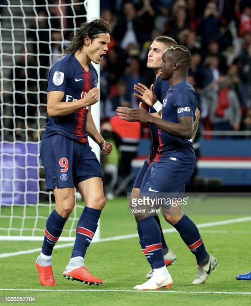 Edinson Cavani of Paris SaintGermain celebrates his goal with Moussa Diaby and Marco Verratti during the French Ligue 1 match between Paris Saint...